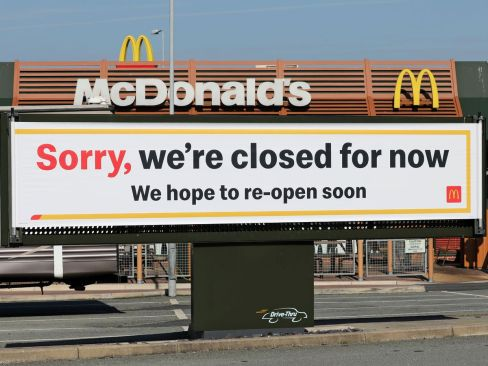 0_A-sign-outside-the-temporarily-closed-McDonalds-restaurant-in-Holyhead-during-the-coronavirus-crisi